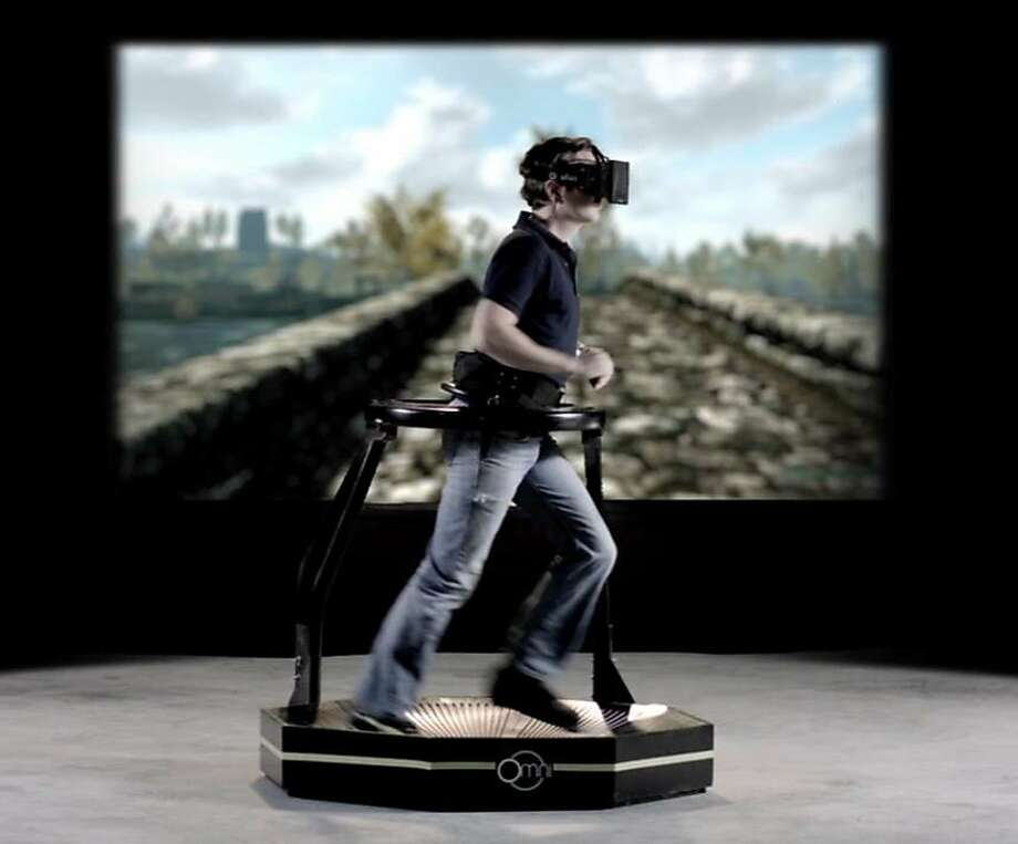 The Virtuix Omni treadmill allows players to walk, run or jump when using virtual-reality devices. Photo: Virtuix