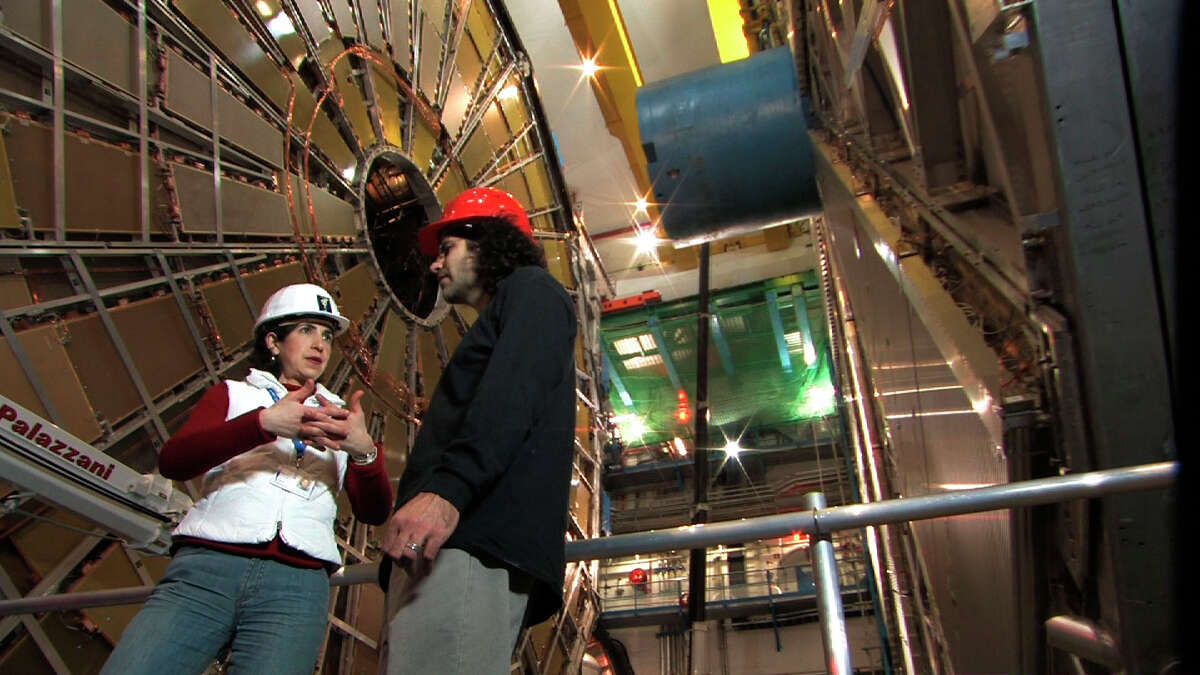 """Fabiola Gianotti and David Kaplan in ATLAS Cavern for the documentary """"Particle Fever"""""""
