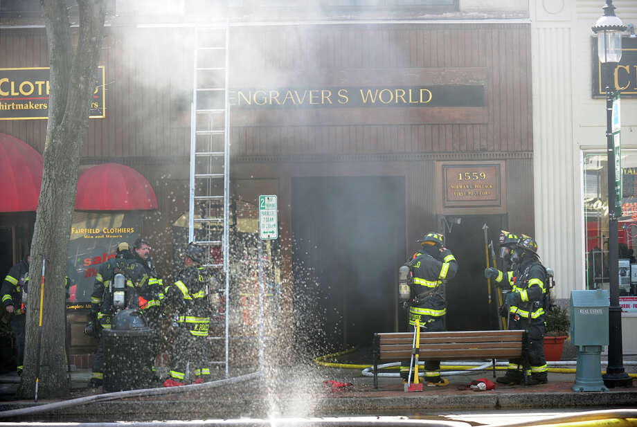 Firefighters on the scene of a fire at the Engraver's World store at 1550 Post Road in downtown Fairfield, Conn. on Thursday, March 27, 2014. Photo: Brian A. Pounds / Connecticut Post