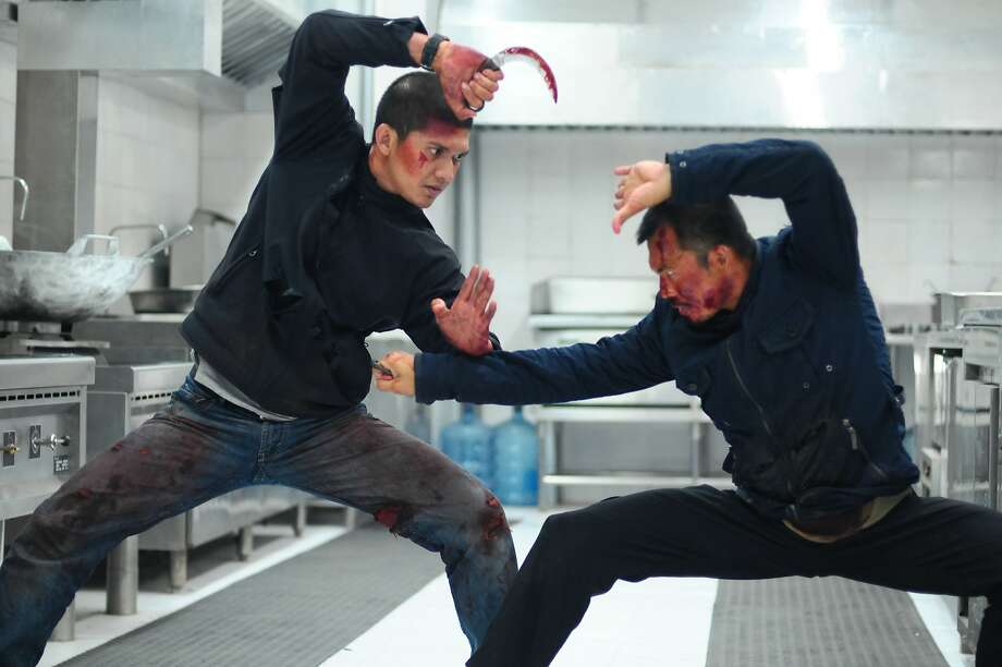 "Iko Uwais (left) faces villain Cecep Arif Rahman in the climactic fight of ""The Raid 2"" - a fight that took 10 days to shoot and totals 196 shots in the final edit. Photo: Associated Press"