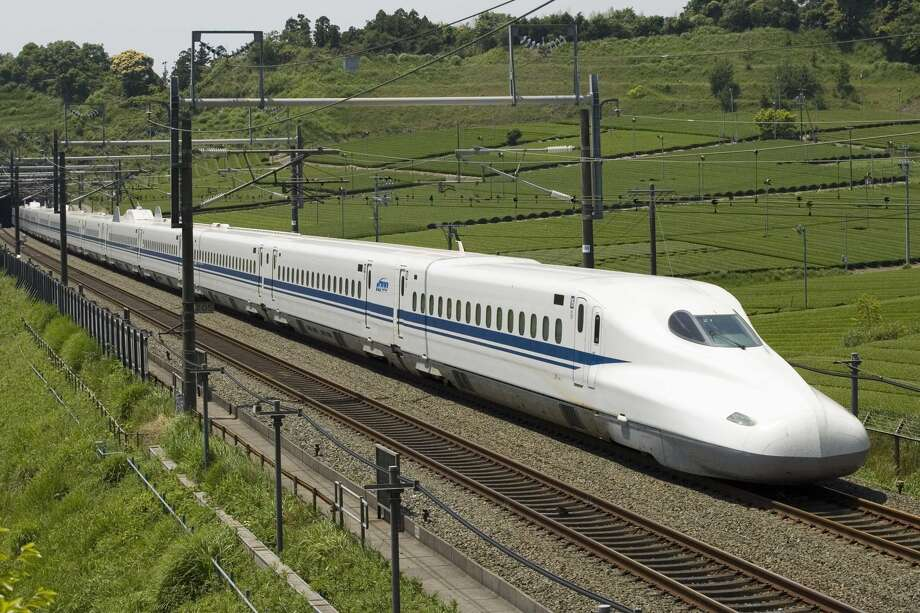 The planned high-speed rail line between Houston and Dallas would use overhead electrical lines and its own separated tracks to shuttle riders between the two metro areas, through mostly flat, rural land. The N700 train is shown in this photo illustration from Texas Central Railway, using images provided by Japan Railway Central. Photo: Texas Central Railway