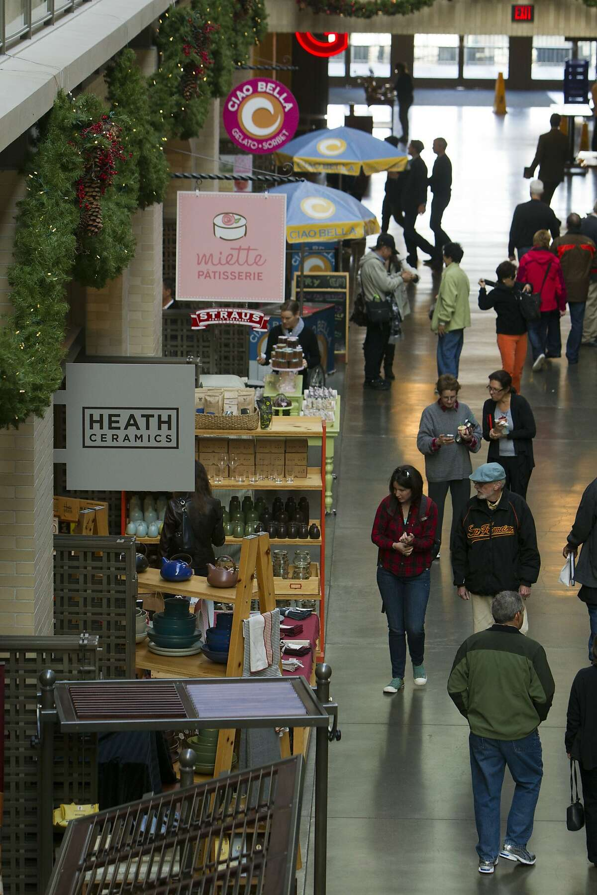 Shoppers walk through the Ferry Building Marketplace in San Francisco on Wednesday, November 16, 2011.