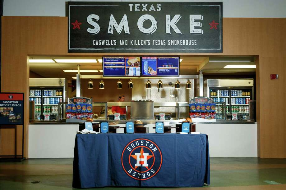 Foodies and barbecue fans will flock to Texas Smoke — Caswell's and Killen's Texas Smokehouse. The new concession stand in Section 124 from local chefs Bryan Caswell and Ronnie Killen will serve country-style barbecue, burgers and classic country sides like baked beans, potato salad and coleslaw. Photo: Michael Paulsen, Staff / © 2014 Houston Chronicle