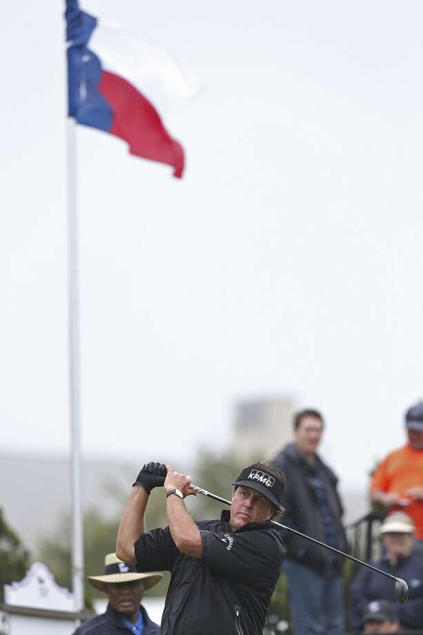 Phil Mickelson practices his swing before the start of the first round of the 2014 Texas Open at TPC San Antonio, Thursday, March 27, 2014. Photo: Jerry Lara, San Antonio Express-News