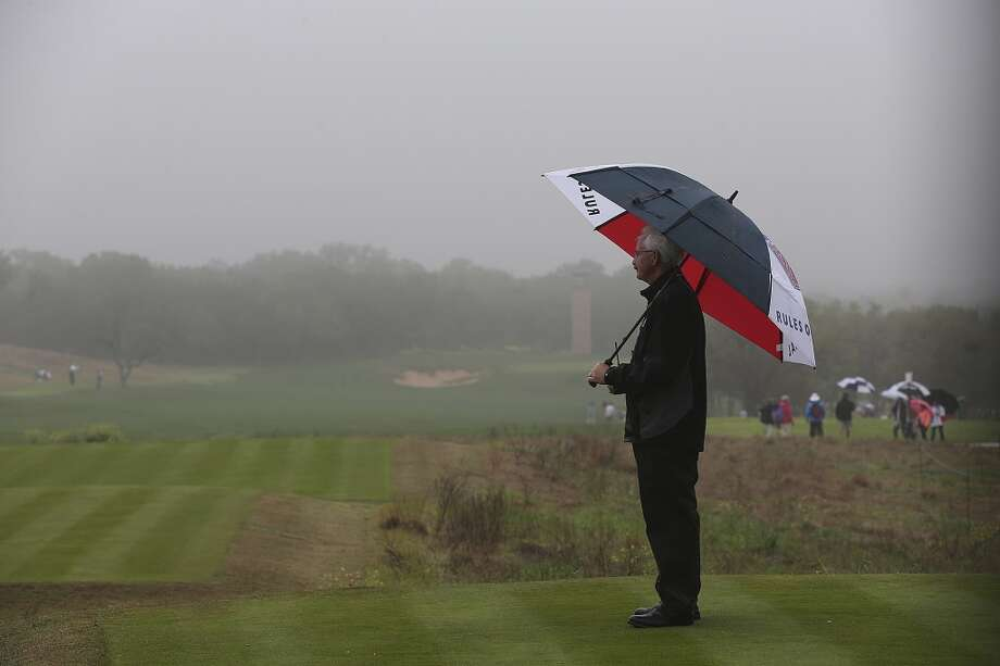 Montana Thompson waits for the start of play on the 10th tee before the first round of the 2014 Texas Open at TPC San Antonio, Thursday, March 27, 2014. Fog delayed the start of the tournament by 2 and a half hours. Photo: Jerry Lara, San Antonio Express-News