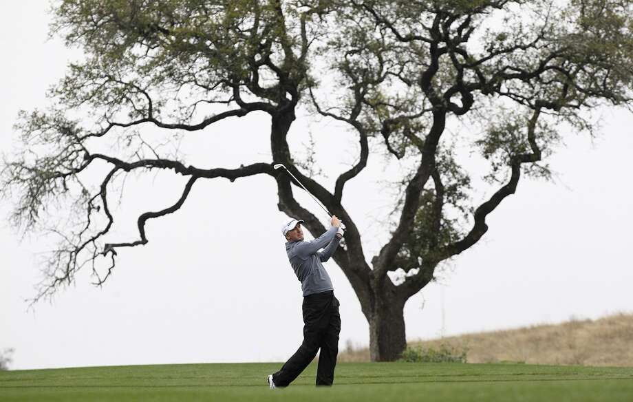 Defending champion Martin Laird takes a shot from the 10th fairway during the first round of the 2014 Texas Open at TPC San Antonio, Thursday, March 27, 2014. Photo: Jerry Lara, San Antonio Express-News