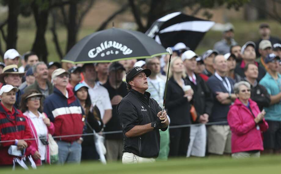 Phil Mickelson looks at his shot on to the 10th green during the first round of the 2014 Texas Open at TPC San Antonio, Thursday, March 27, 2014. Photo: Jerry Lara, San Antonio Express-News