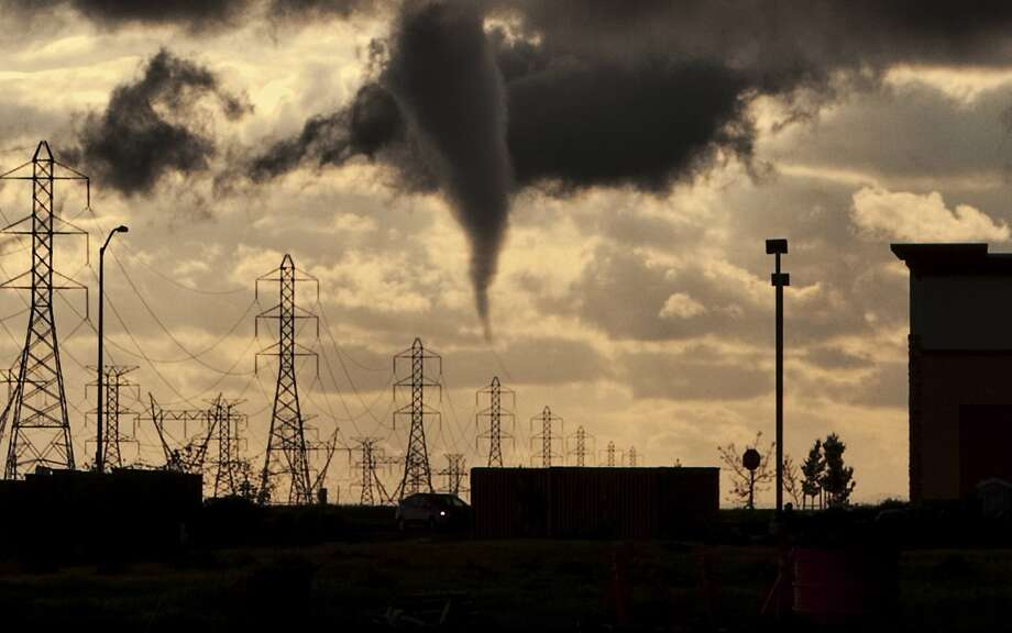 A funnel looms over Roseville, where a tornado touched down and left a dozen to 20 houses damaged. Photo: Handout, Reuters