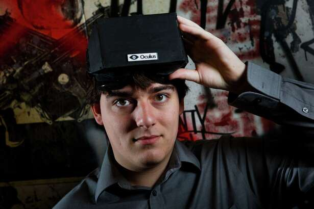FILE -- Palmer Luckey, the creator of the Oculus Rift virtual reality gaming headset, at his workshop in Irvine, Calif., Feb. 6, 2013. Facebook announced on March 26, 2014, that it was buying Oculus for $2 billion, signaling its belief in virtual reality as an essential platform for future growth.