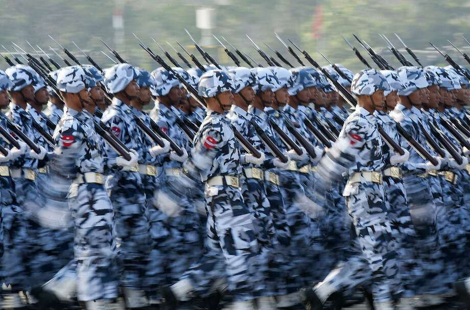 Cool uniforms, Myanmar army!Soldiers march in formation for Armed Forces Day in 