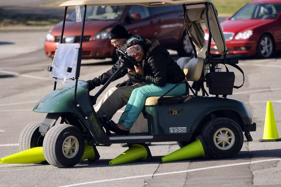 You missed one:Red Bank (Tenn.) High School junior Tamia Foster tries to navigate a cone course in a golf   cart during a program simulating DUI and distracted driving. Red Bank Police Officer Tim   Brown accompanies Tamia during the plastic carnage. Photo: Tim Barber, Associated Press