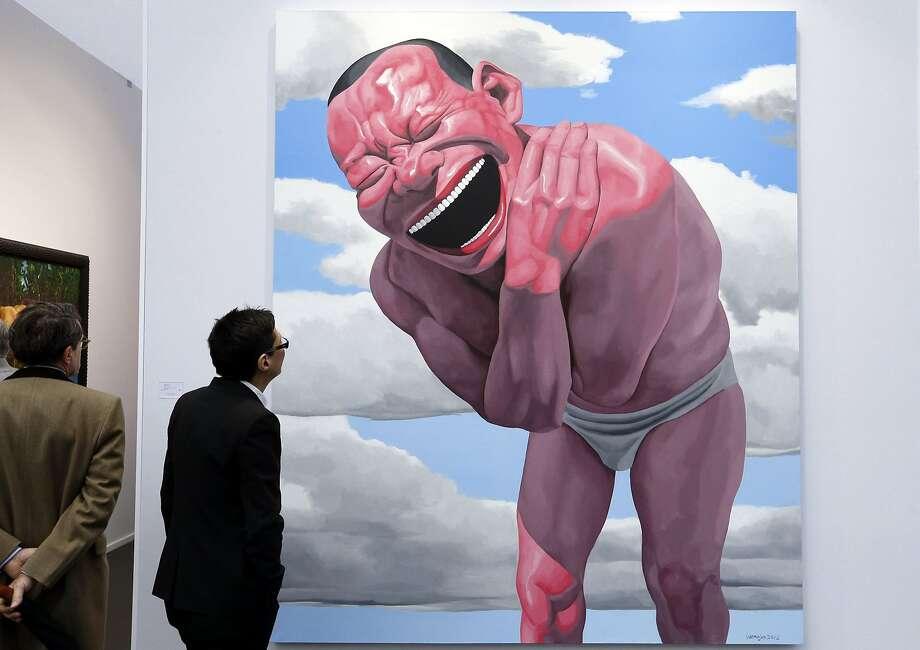 "The gaping grinof Chinese artist Yue Minjun greets visitors at the Art Paris Art Fair where Yue's self-portrait ""Blue Sky and White Clouds"" is on display. Yue is known for depicting himself with a similar expression in his many paintings and sculptures. Photo: Francois Guillot, AFP/Getty Images"
