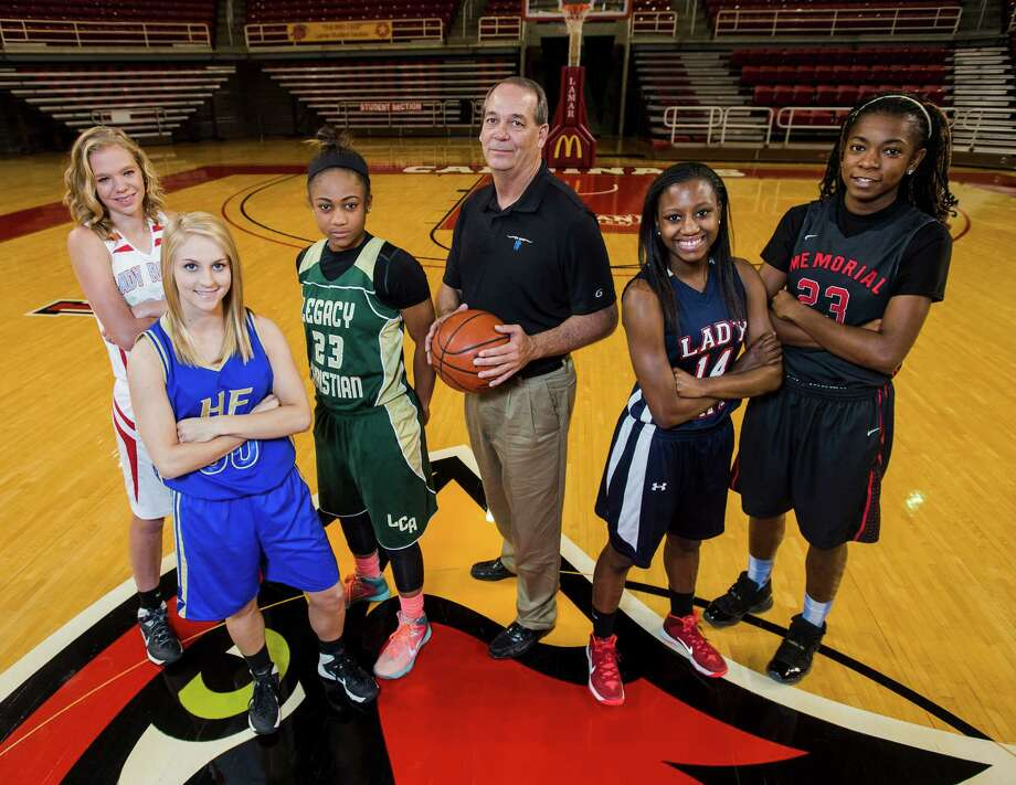 The Super Gold girls team -- Lumberton's Megan Worry, Hamshire-Fannett's Hannah Hulet, Legacy Christian's Alexis Morris, Hamshire-Fannett Coach Colin Toot, Hardin-Jefferson's Kesha Broussard, and Port Arthur Memorial's Jakeira Ford, left to right -- poses for a picture Wednesday. The 2014 Super Gold basketball team members posed for pictures at the Montagne Center on Wednesday. Photo taken Wednesday, 3/12/14 Jake Daniels/@JakeD_in_SETX Photo: Jake Daniels / ©2014 The Beaumont Enterprise/Jake Daniels