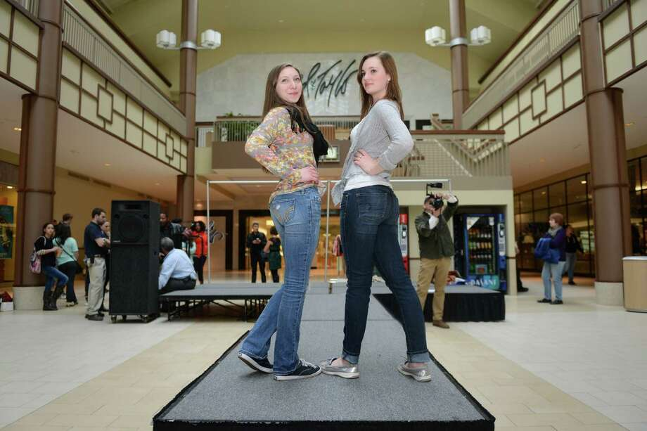 New Milford students Lea Krebs, left, 16, and Alexa Sullivan, 17, practice their runway poses during the Building With Style Prom & Spring Fashion Show rehearsal at the Danbury Fair in Danbury, Conn. on Thursday, March 27, 2014.  The show, featuring more than 50 Danbury and New Milford students, will be Friday at 6:30 p.m. at the Lord & Taylor wing of the Danbury Fair.  Students will demonstrate the latest in spring and prom fashion, featuring styles from 10 mall retailers.  Proceeds from the fashion show benefit the Housatonic Habitat for Humanity. Photo: Tyler Sizemore / The News-Times