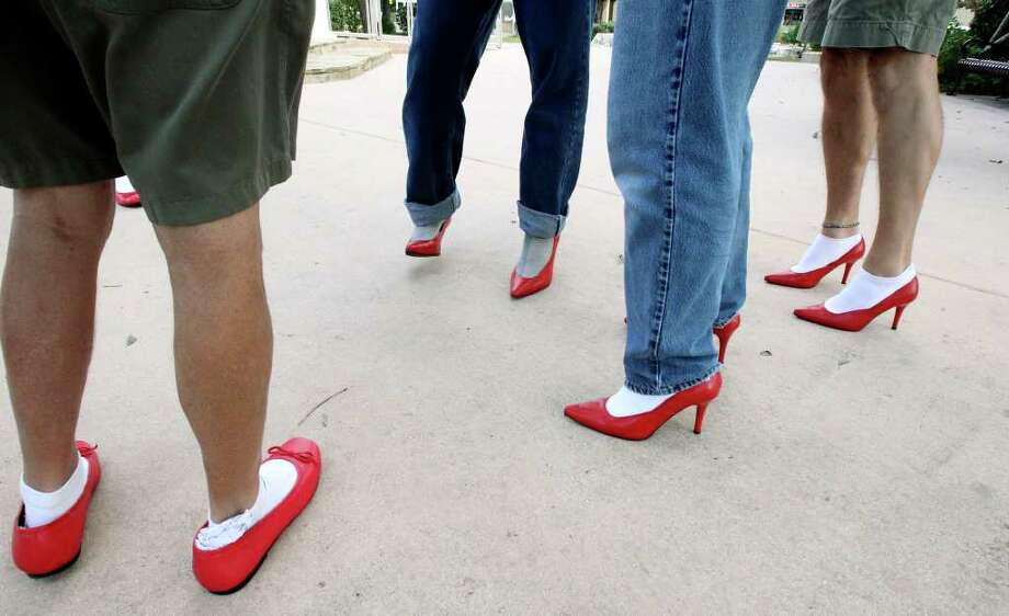 "Guys get accucstomed to shoes before  ""Walk a Mile in Her Shoes"", a fundraiser for the Kendall County Women's Shelter and awareness-raiser for Domestic Violence Awareness Month. Photo: TOM REEL, SAN ANTONIO EXPRESS-NEWS / © 2011 San Antonio Express-News"