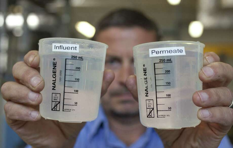 Robert James of the California American Water Co. looks over samples at a desalination plant in Sand City, Calif. Texas lawmakers are weighing desalination as a means to partially relieve the state's water woes. (Associated Press) Photo: Associated Press / AP