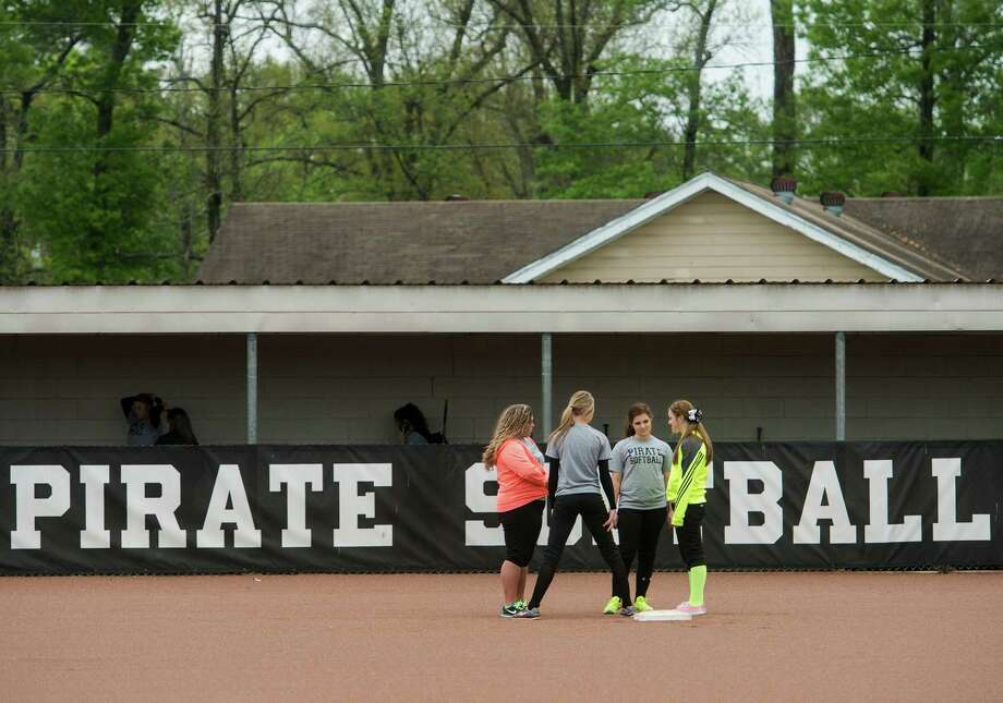 Softball players wait for practice to begin Wednesday. The Vidor High School softball team practiced Wednesday afternoon before rain drove them off the field. Photo taken Wednesday, 3/26/14 Jake Daniels/@JakeD_in_SETX Photo: Jake Daniels / ©2014 The Beaumont Enterprise/Jake Daniels