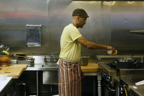 Chef Eskender Aseged, 52, prepares kabocha squash alicha at his restaurant Radio Africa & Kitchen on February 8, 2014 in San Francisco, Calif.  The dish is made with kabocha squash, beluga lentils and fresh rainbow Swiss chard.