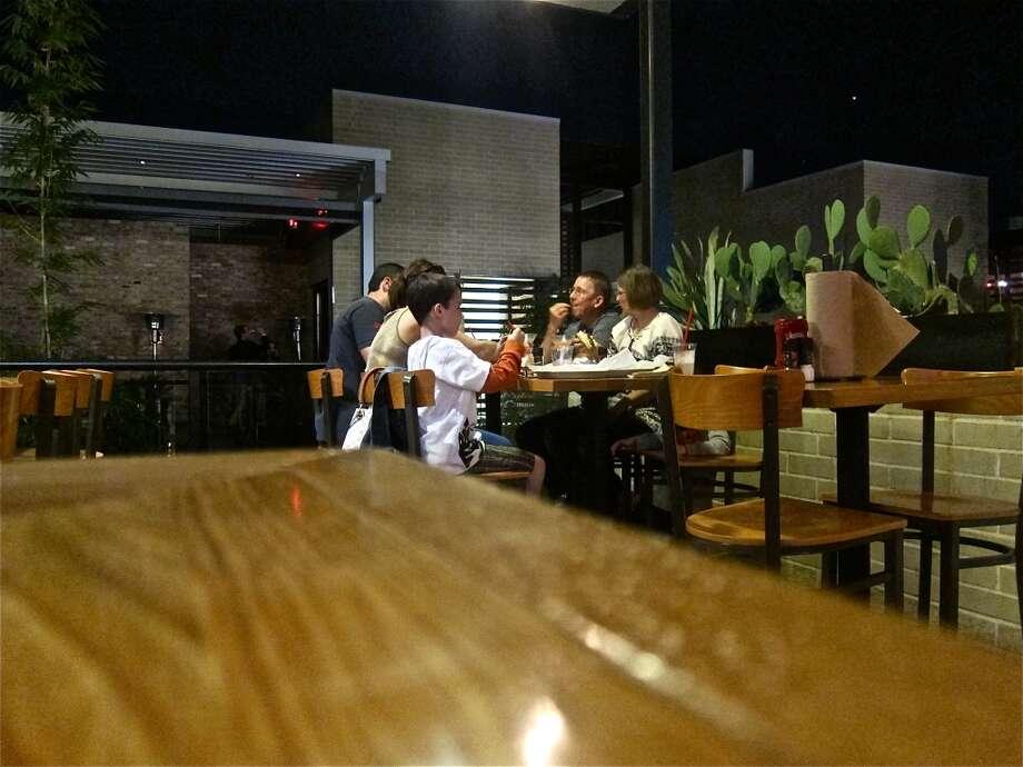 Outdoor covered seating at Grub Burger Bar at City Centre.