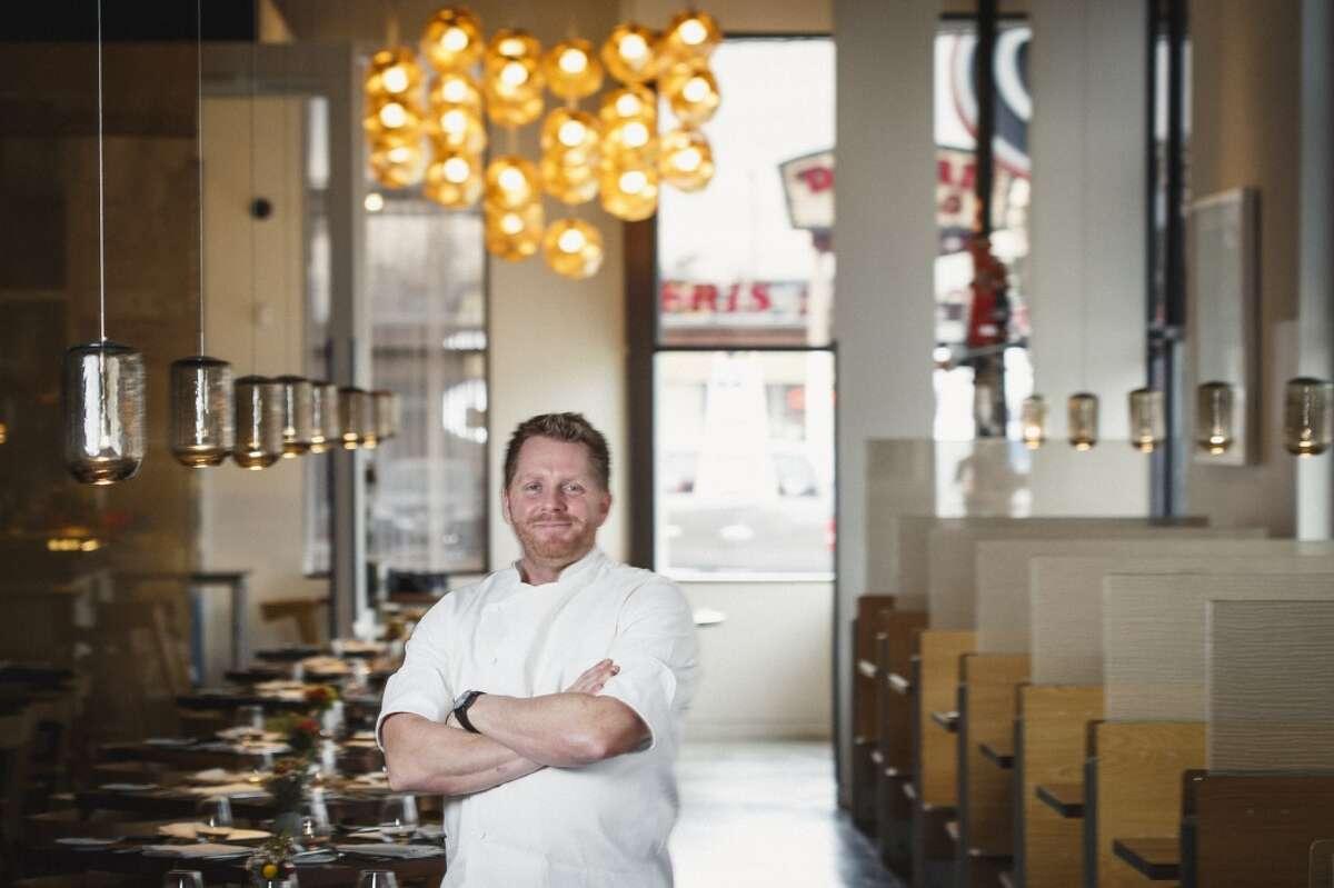 Chef Ryan Hildebrand poses for a photo at his restaurant, Triniti