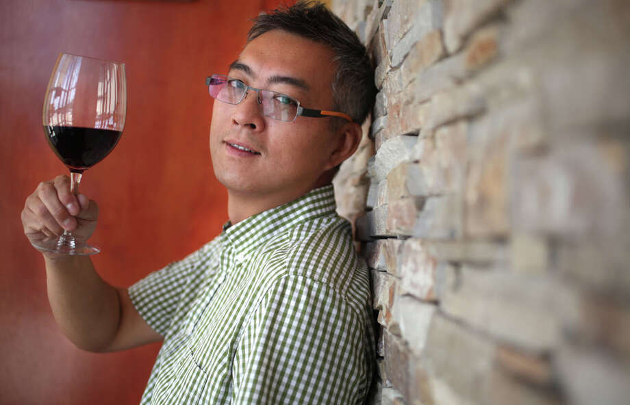 Ron Chen, owner Rattan Bistro & Wine Bar, a Pan-Asian (Japan, Thai, Chinese and Malaysian cuisines) restaurant in Energy Corridor on Monday, July 11, 2011, in Houston. ( Mayra Beltran / Chronicle ) Photo: Mayra Beltran, Chronicle / © 2011 Houston Chronicle