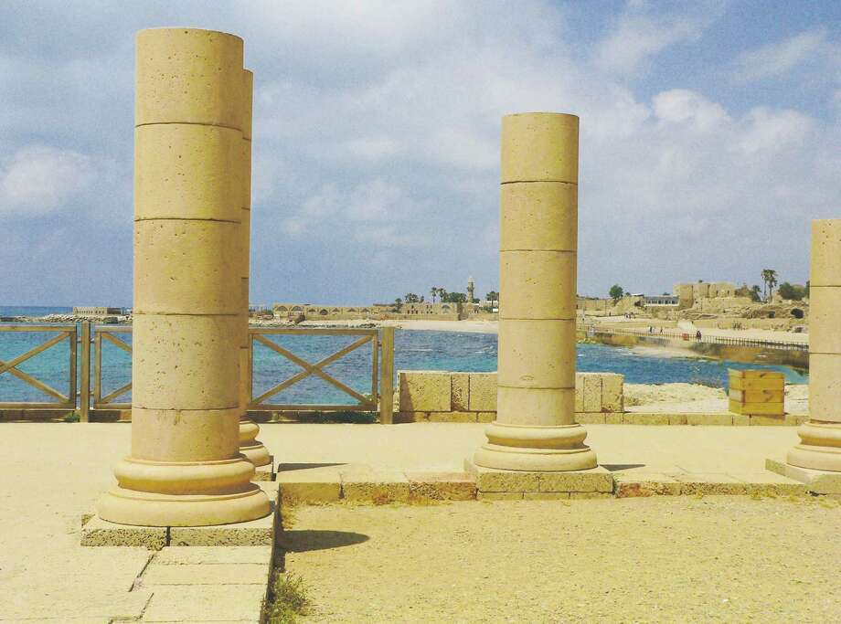 In Caesarea port, columns from the biblical ruins of Herod the Great's palace look across the harbor to the medieval ruins of fortifications built by the crusaders. Photo: Photos By Wendy Lemlin / For The Express-News