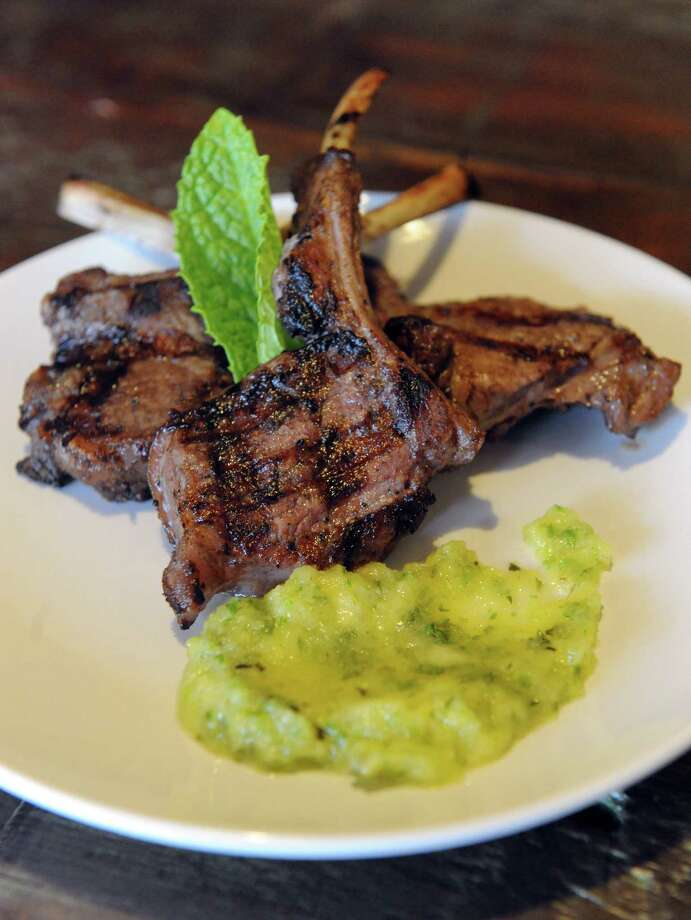 Jerk lamb lollipop appetizer with pineapple mint sauce at the Umana Wine Bar and Restaurant at 236 Washington Avenue Thursday, March 20, 2014, in Albany, N.Y. (Michael P. Farrell/Times Union) Photo: Michael P. Farrell / 00026221A