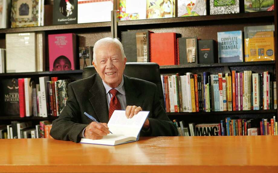 "A reader lauds former President Jimmy Carter, shown here signing copies of his new book, ""A Call To Action: Women, Religion, Violence, And Power,"" for coming up with a solution to the NSA snooping. Photo: Jemal Countess / Getty Images / 2014 Getty Images"