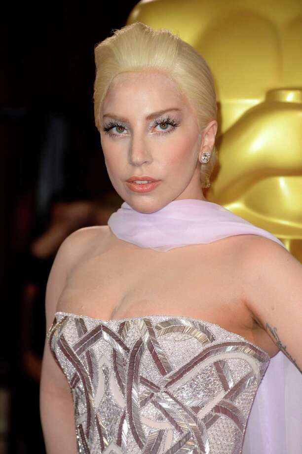 Lady Gaga arrives at the Oscars on Sunday, March 2, 2014, at the Dolby Theatre in Los Angeles.  (Photo by Dan Steinberg/Invision/AP) ORG XMIT: CAJA137 Photo: Dan Steinberg / Invision