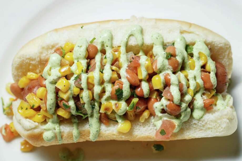 A sneak peak at the new Tex Mex Dog at Minute Maid Park this season, Thursday, March 27, 2014, in Houston. Photo: Michael Paulsen, Houston Chronicle / © 2014 Houston Chronicle