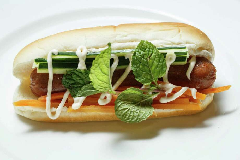 A sneak peak at the new Bahn Mi Dog at Minute Maid Park this season, Thursday, March 27, 2014, in Houston. Photo: Michael Paulsen, Houston Chronicle / © 2014 Houston Chronicle