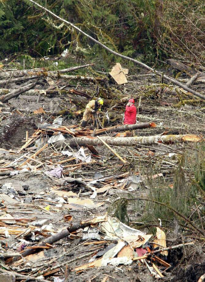 Searchers work on a massive pile of debris at the scene of a deadly mudslide Thursday in Oso.  Photo: Mark Mulligan, Associated Press / AP2014
