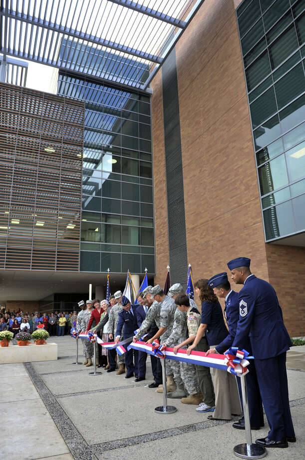 Dignitaries cut the ribbon to open the seven-story, 760,000-square-foot San Antonio Military Medical Center Oct. 7, 2011. Cuts in funding could affect civilian care, experts suggest. Photo: File / San Antonio Express-News / SAN ANTONIO EXPRESS-NEWS