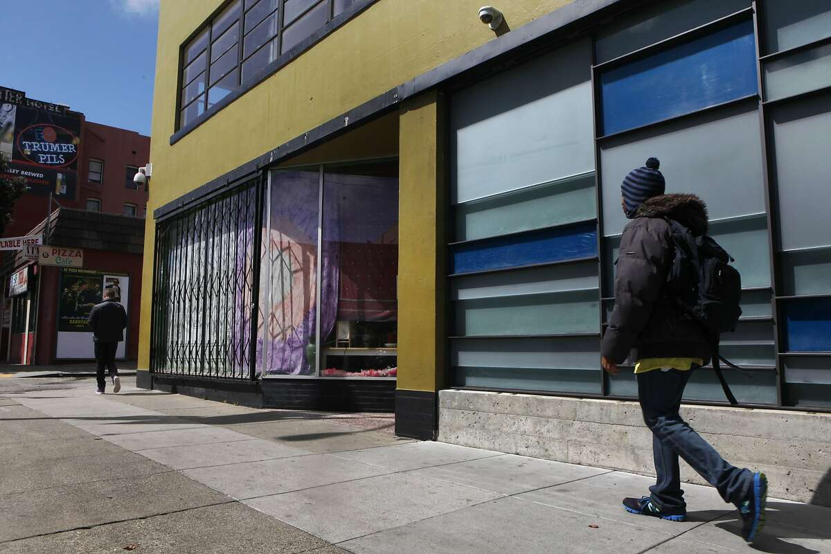 A pedestrian walks past the front of the non-profit SPARC dispensary building March 26, 2014 in San Francisco, Calif. SPARC provides affordable medical marijuana to its members as well as education on other alternative health options for medical supplements.