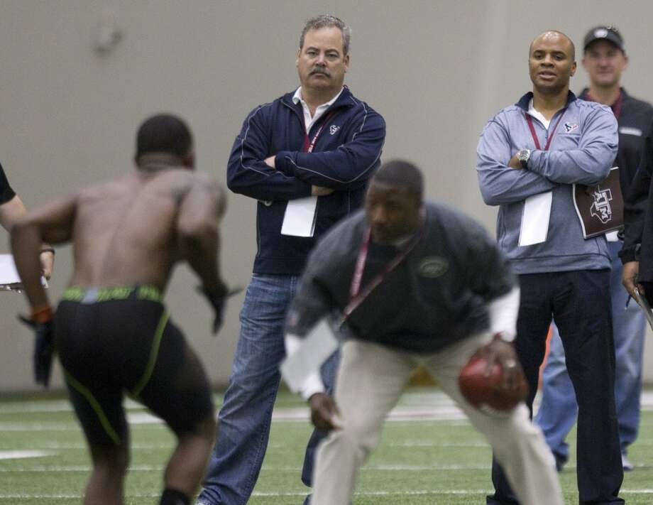 Cal McNair, Texans COO, left, and Rick Smith, Texans general manager, watch during Johnny Manziel's pro day. Photo: Brett Coomer, Houston Chronicle
