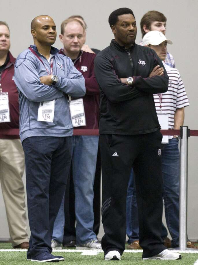 Texans general manager Rick Smith, left, and A&M head coach Kevin Sumlin watch former Aggies quarterback Johnny Manziel pass. Photo: Brett Coomer, Houston Chronicle