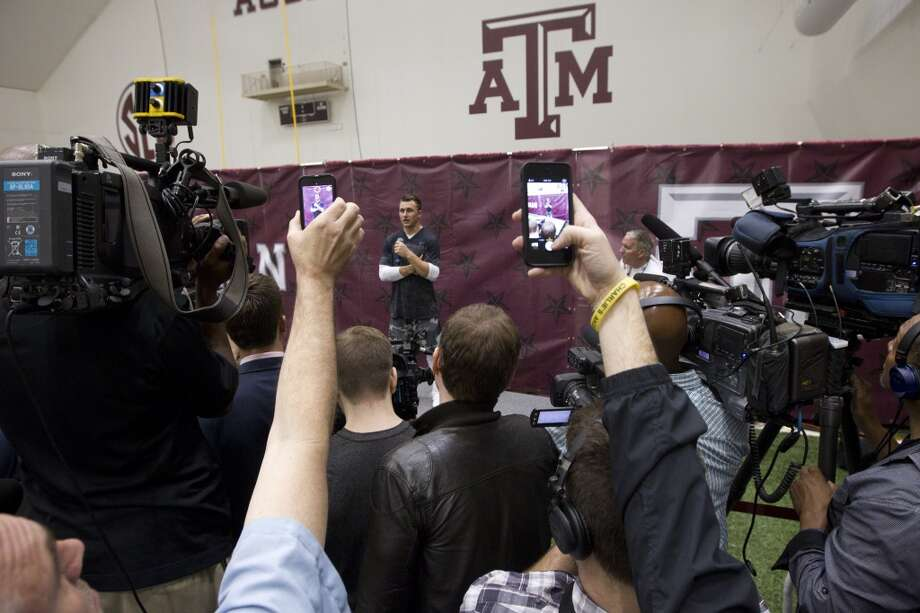 Former Texas A&M quarterback Johnny Manziel is surrounded by media following his pro day. Photo: Brett Coomer, Houston Chronicle
