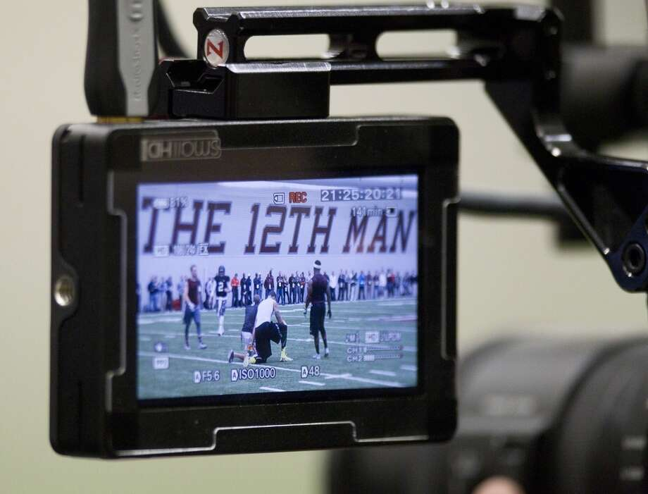 A television monitor shows Johnny Manziel during Manziel's pro day. Photo: Brett Coomer, Houston Chronicle