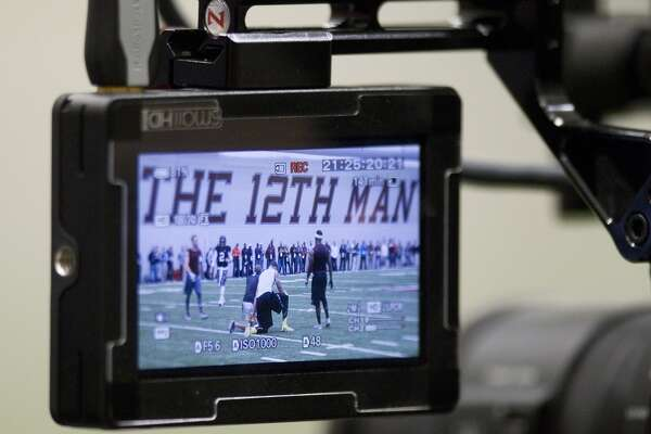 A television monitor shows Johnny Manziel during Manziel's pro day.