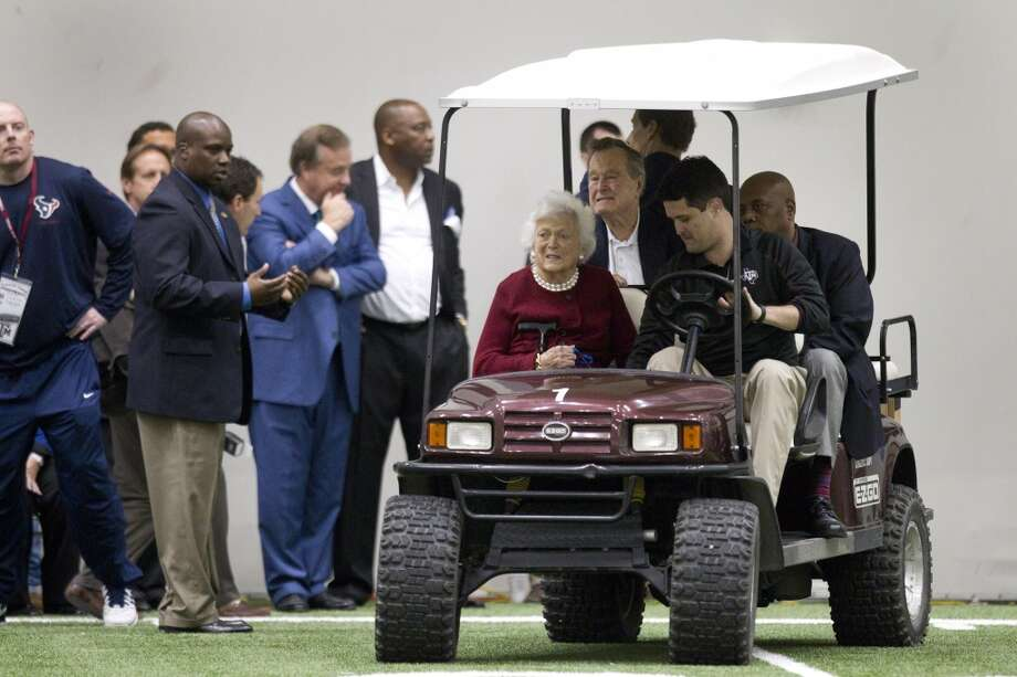 Former President and First Lady George and Barbara Bush arrive to watch former Texas A&M quarterback Johnny Manziel throw passes during Manziel's pro day. Photo: Brett Coomer, Houston Chronicle