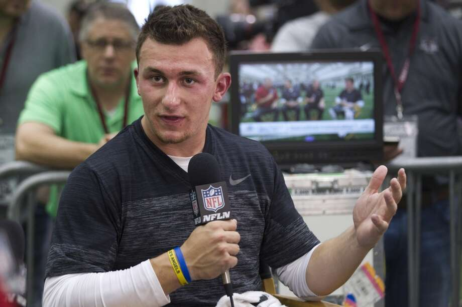 Former Texas A&M quarterback Johnny Manziel gives an interview to the NFL Network following his pro day. Photo: Brett Coomer, Houston Chronicle