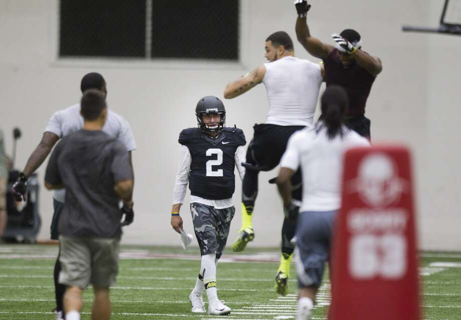 Former Texas A&M quarterback Johnny Manziel (2) walks off the field following his pro day. Photo: Brett Coomer, Houston Chronicle