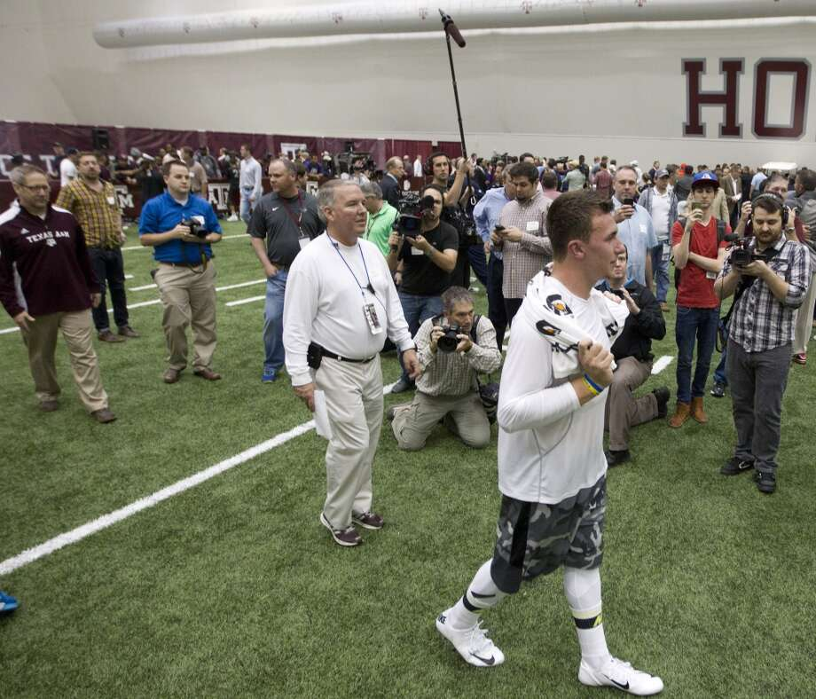 Former Texas A&M quarterback Johnny Manziel walks on the field following his pro day. Photo: Brett Coomer, Houston Chronicle