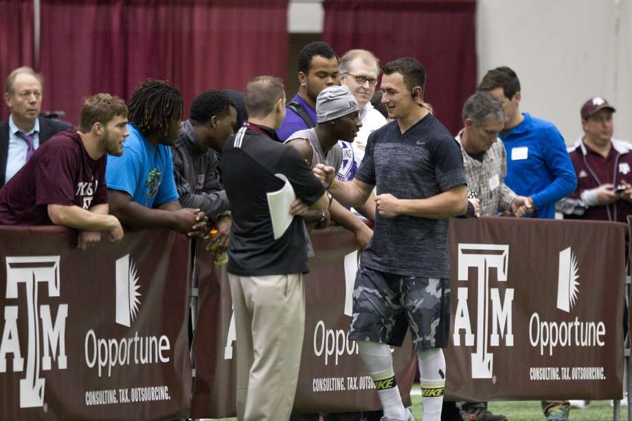 Former Texas A&M quarterback Johnny Manziel greets fans during his pro day. Photo: Brett Coomer, Houston Chronicle