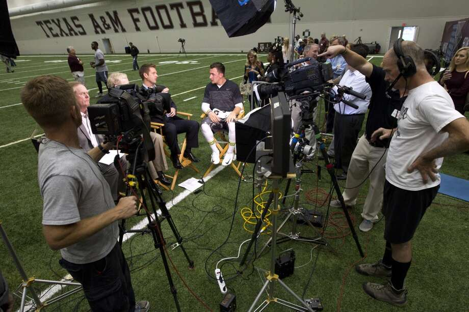 Former Texas A&M quarterback Johnny Manziel is interviewed by ESPN following Manziel's pro day. Photo: Brett Coomer, Houston Chronicle