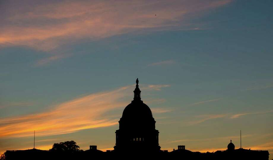 FILE - In this Sept. 15, 2013, file photo, the U.S. Capitol dome is silhouetted by the sunrise. Doctors who treat Medicare patients would get a last-minute reprieve from a scheduled 24 percent cut in their reimbursements from the government under a bill that's on track to pass the House. It would be the 17th time Congress has stepped in with a temporary fix to a poorly designed Medicare fee formula that dates to a 1997 budget law. House action comes after efforts to permanently fix the formula appear to have fizzled.  (AP Photo/Carolyn Kaster, File) Photo: Carolyn Kaster, STF / AP