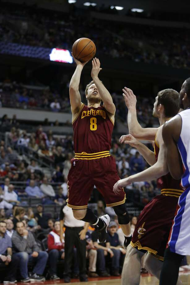 Cleveland Cavaliers guard Matthew Dellavedova (8) takes a shot against the Detroit Pistons during the second half of an NBA basketball game Wednesday, March 26, 2014, in Auburn Hills, Mich. (AP Photo/Duane Burleson) Photo: Duane Burleson, Associated Press