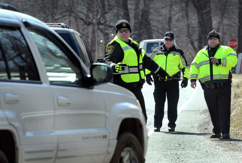 """Police from area departments combined forces Thursday for the third wave of the """"Phone in One Hand, Ticket in the Other"""" campaign. Police set up along Route 7 near the Ridgefield/ Redding  border to stop drivers violating the cellphone law, Thursday, March 27, 2014. Photo: Carol Kaliff / The News-Times"""