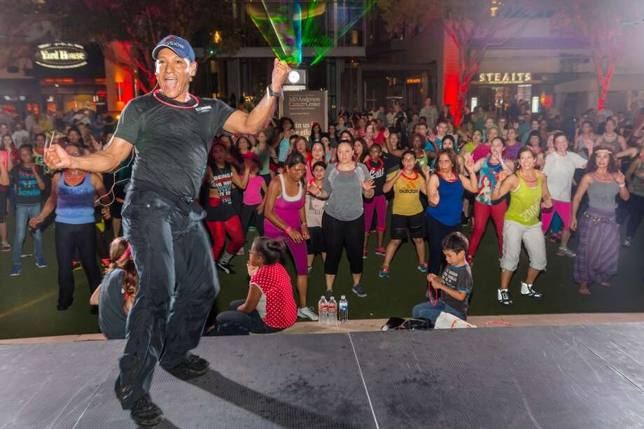 Roberto Cubias, Zumba instructor at LIFE TIME fitness, led a class of more than 500 at the MD Anderson Regional Care Centers Ride of a Lifetime event on Saturday, March 22 in CITYCENTRE plaza. Photo: Terry Halsey   Th@terryhalsey.co