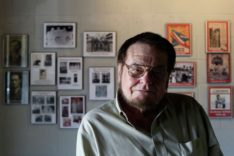 Bruce Hathaway sits in front of images of himself throughout his career hanging on the wall of TEX POP, the South Texas Popular Culture Center, in San Antonio on Tuesday, March 25, 2014. Photo: SAN ANTONIO EXPRESS-NEWS / SAN ANTONIO EXPRESS-NEWS